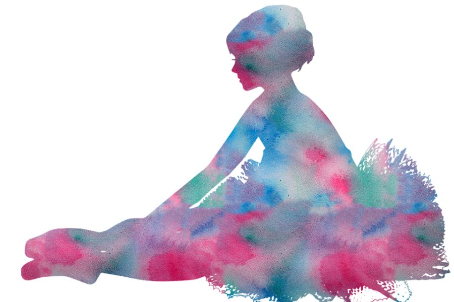 Zdjęcie przedstawia kolorową baletnicę siedzącą na podłodze