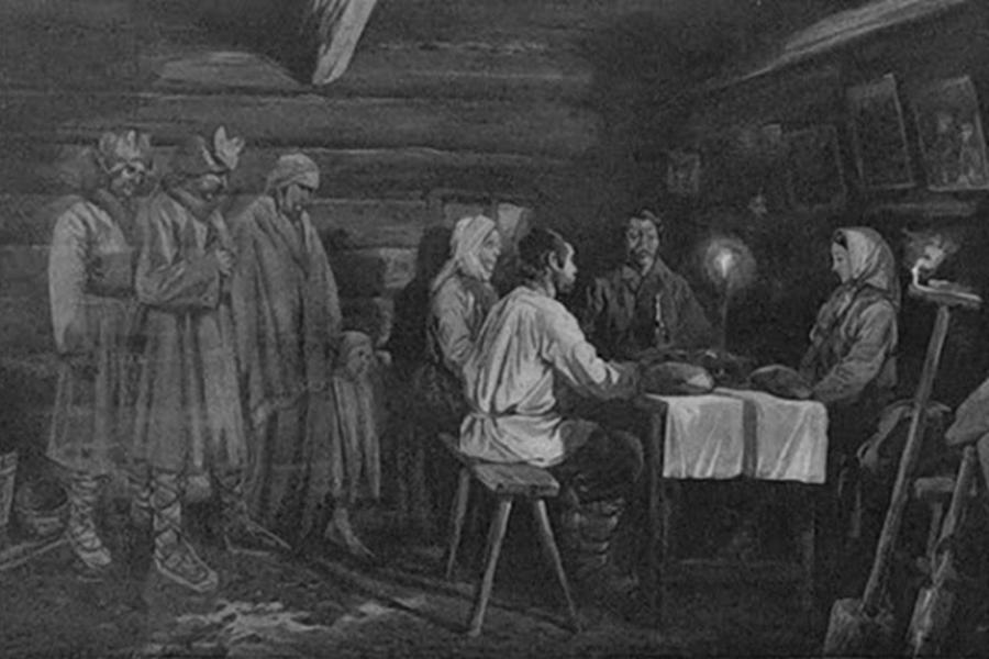 wnętrze starej chaty, przy stole siedzi czworo ludzi obok stołu stoją trzej mężczyźni i dziecko