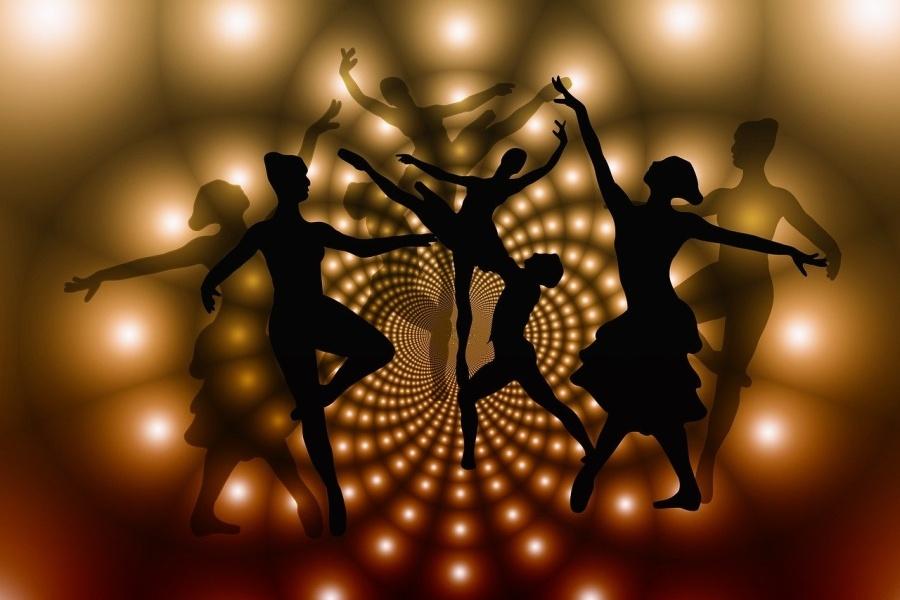 grafika - czarne postacie tancerek na złotym tle