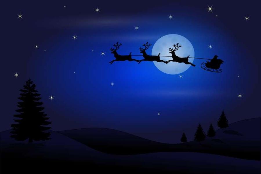 bajkowa grafika przedstawiająca kształt sań Mikołajowych na tle tarczy Księżyca