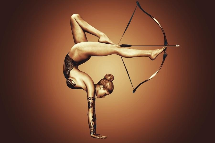 Zdjęcie przedstawia dziewczynę w pozie lekkoatletycznej z łukiem Arrow