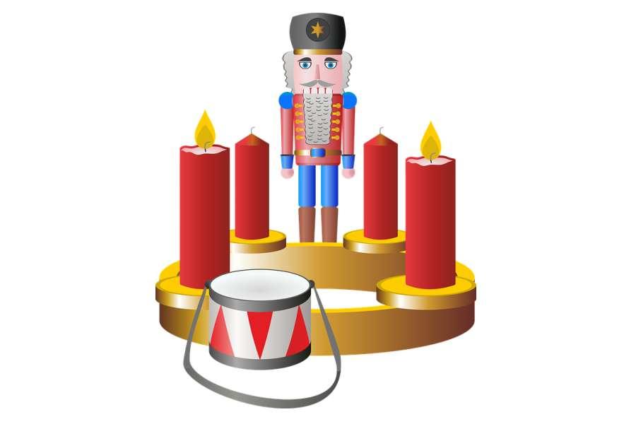 Rysunek przedstawia namalowanego żołnierzyka, werbel oraz cztery świece.