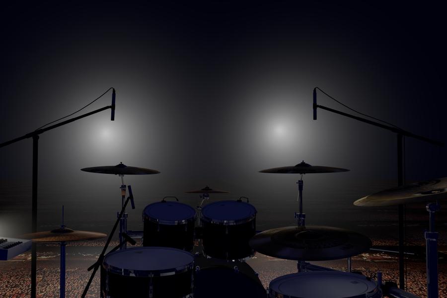 zestaw perkusyjny nagłośniony mikrofonami.
